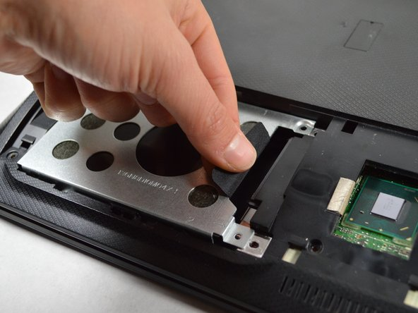 Remove the hard drive by sliding it to the left and lifting up.
