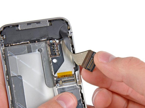 Carefully peel the dock ribbon cable off the logic board and the lower speaker enclosure.