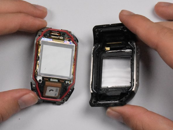 The watch should come apart easily after removing the screws. If you experience difficulties separating the housing and and back cover, use a spudger to gently pry apart the back panel and the button and screen protector housing.