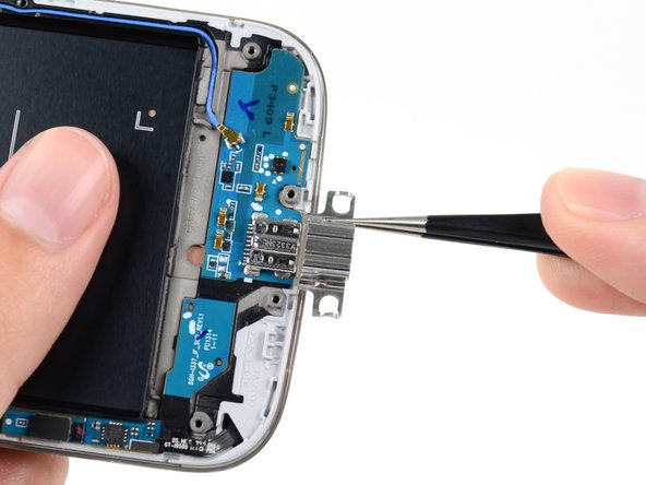 Image 1/1: Remove the USB port bracket from the USB port.