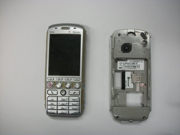 Once the tabs are dislocated, pull the back of the phone apart from the front half.