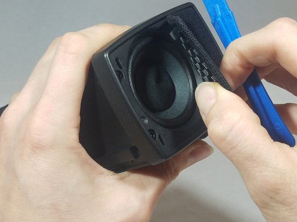 Using your fingers, lift up on the end cap cover until it separates completely from the main body of the device.