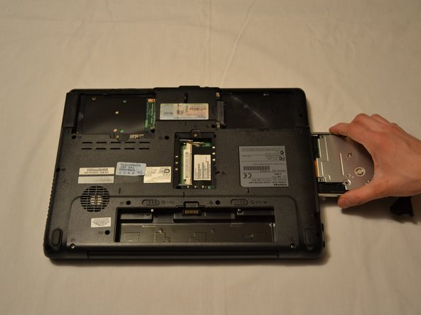 Grasp the drive tray and gently but firmly pull it out of the laptop chassis.