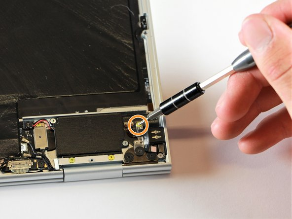 Remove the gold 3.0mm screw by using a T3 Torx screwdriver to turn it counterclockwise.