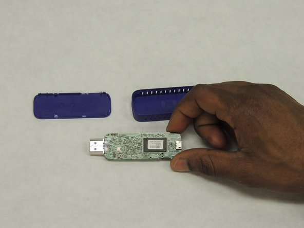 Remove the motherboard by grabbing a hold of the micro-usb port,   or you can also use tweezers  to grab a hold of it and pull it out. But be careful with where you grab the motherboard.