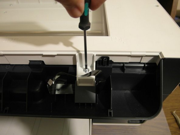 Remove the two T8 screws to detach the scanner cover.