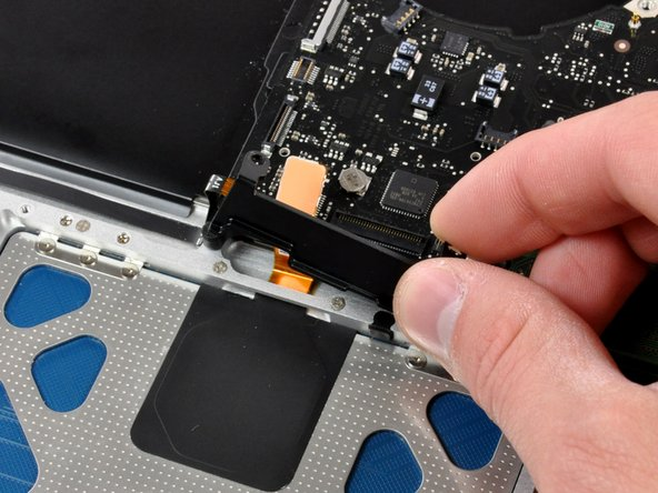 Lift the keyboard flex bracket out of the upper case.