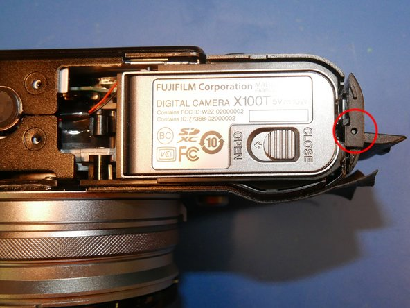 To get any deeper into this camera, the right-hand port cover assembly must be removed first. Once this is removed, you will have access to the screws that secure the other components.