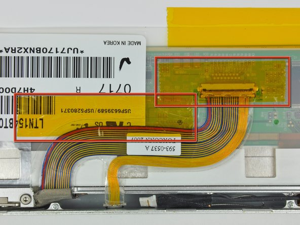 Image 1/2: Remove the two pieces of kapton tape covering the display data cable.