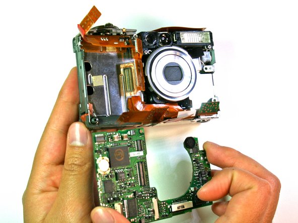 Carefully remove the motherboard from the main frame of the camera body.