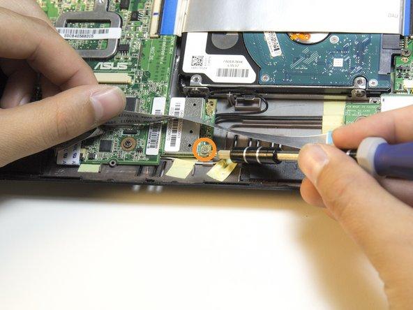 Image 2/2: Remove the 3.6 mm Phillip #1 screw.