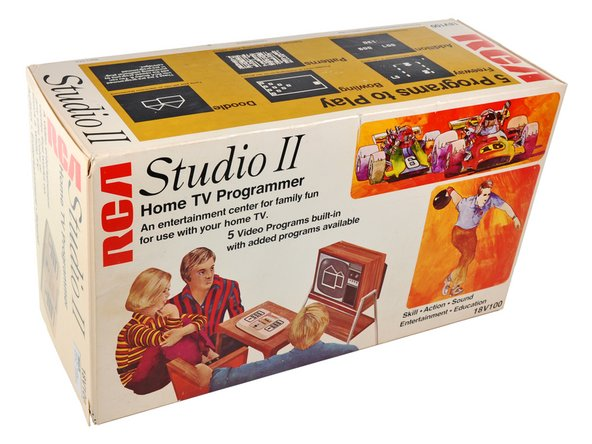 Image 3/3: One of the Studio II's most redeeming features is its box! Tell me you don't want that guy's red and blue striped polyester shirt.