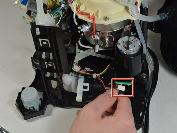 Pull out the white tab that has the wires that connect the Water Sensor to the water pump.