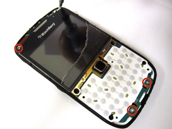 Locate and remove the four 5mm screws on the top and bottom of phone using the T6 Torx screwdriver