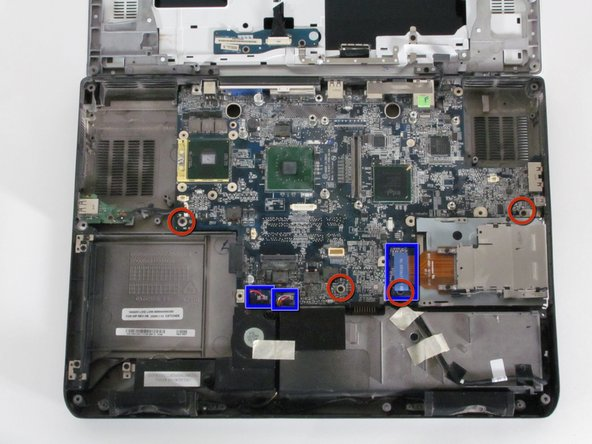 Image 1/1: Remove the shown screws from the motherboard