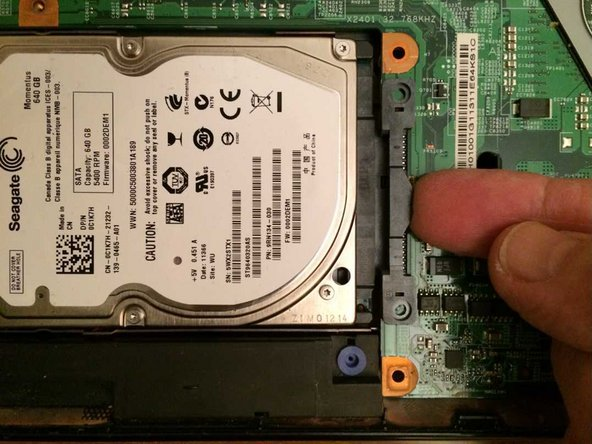 Lift the hard drive connector out of its socket and hence remove the hard drive.