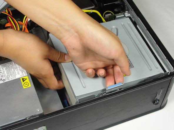 Image 1/2: Slide the optical drive out.