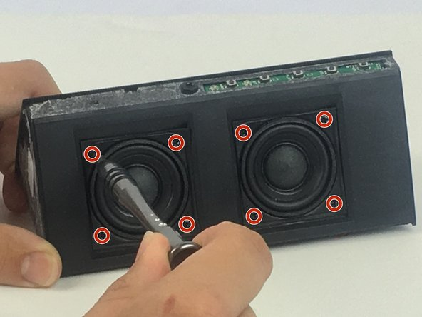 Unscrew the eight ____mm screws holding the speakers in place.