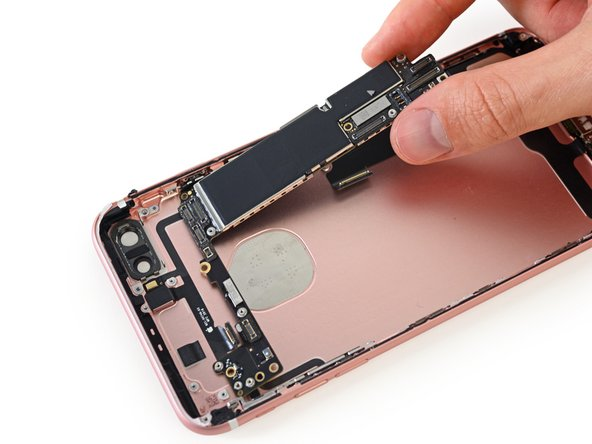 Plucking the logic board from the 7 Plus is much easier than with its predecessor. There's no need to flip over the logic board to remove the final connections.