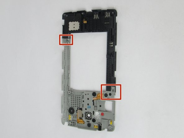 Image 1/3: Indicated on the back panel is where you will use your plastic prying tool to remove the top part from the speaker.