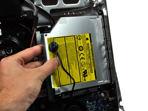 It may be helpful to hold the logic board down near the optical drive connector when pulling the drive toward yourself to avoid both components lifting together.
