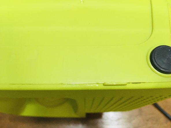 Remove the base by sliding a plastic opening tool or a flat blade screwdriver from the corner.