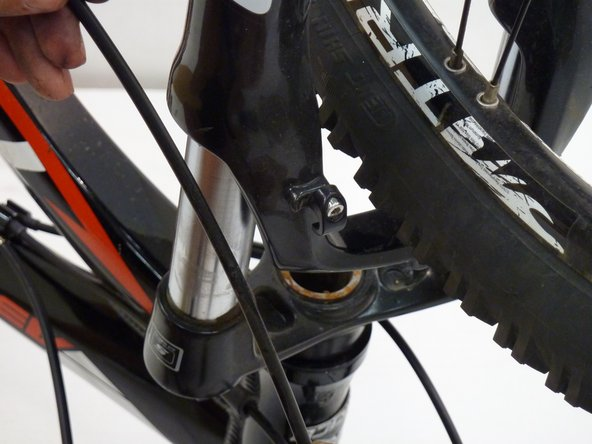 "Note that if removing cable for rear brake, rather than unscrewing a bracket, you will unclip several ""spring"" clips. Keep track of clips."