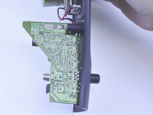Inspect both sides of the printed circuit board (PCB) for any raised traces, off-colored areas, or loose components.