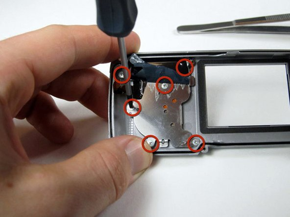 Image 1/1: Remove the six 4.3 mm screws holding the back buttons to the back casing.
