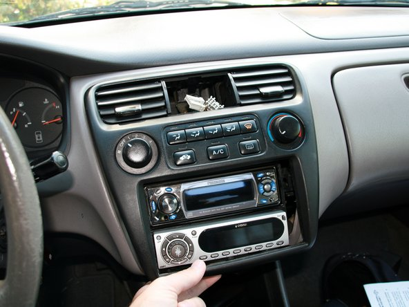 Now, gently pull the bottom of the center console towards you. Don't yank it out, there's two more connectors holding it in place.