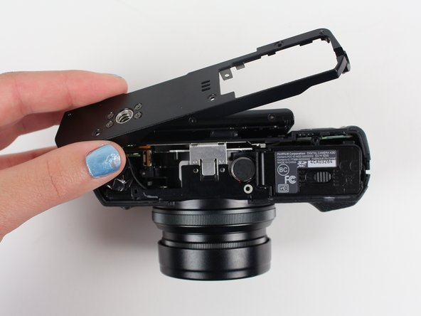 Carefully lift up the bottom piece of the camera to remove it.
