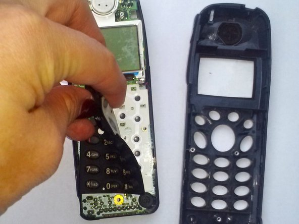 Image 2/3: Push the two parts of the phone back together.  You will here a loud click when the phone is back together.