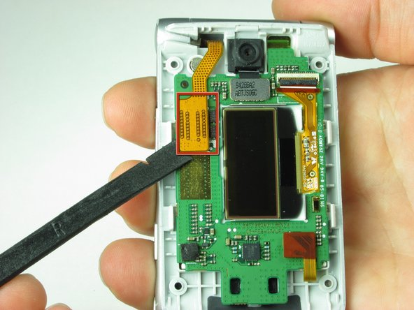 Use spudger to gently disconnect the ribbon cable from phone.
