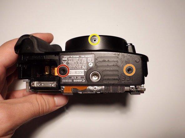 Image 1/1: Remove the single 4 mm Phillips screw.
