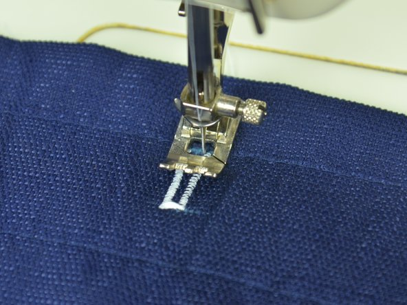 Sew the top bar tack at the top of the buttonhole.