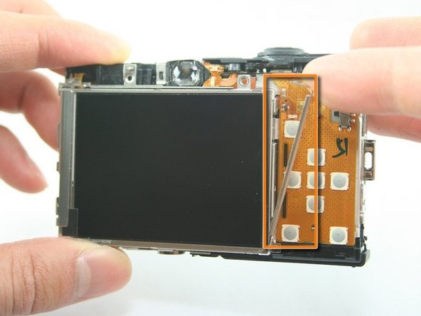 Image 2/2: Remove the L-shaped bar from the right of the LCD screen.