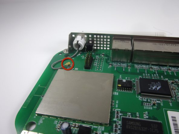 Image 1/3: The wire should now be completely separate from the motherboard.