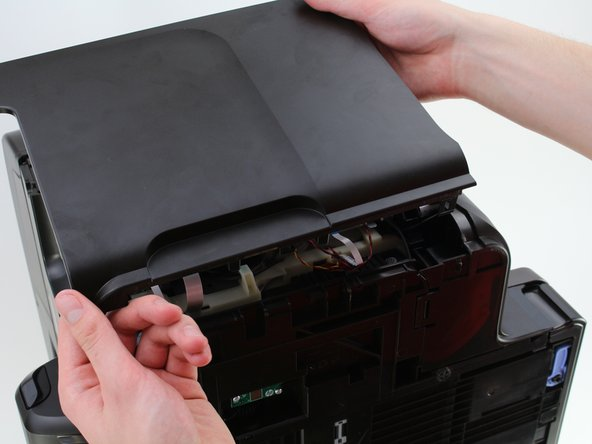 Remove the side panel from the printer by lifting upwards toward you.