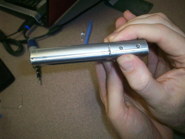 Install the screws on both sides of device as seen in the picture.