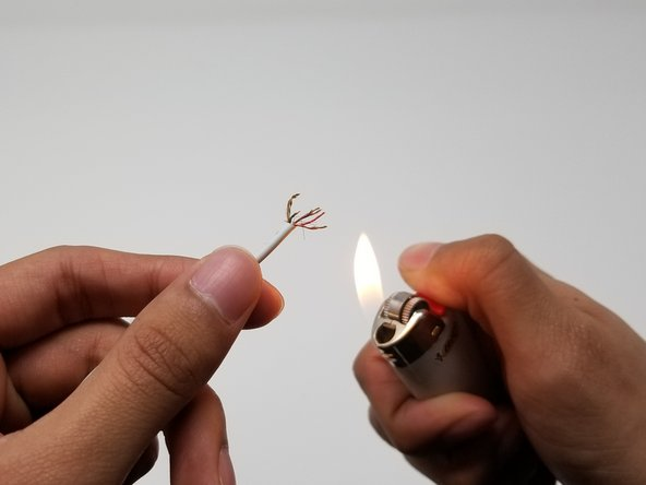 Burn off the insulating wax from the signal carrying wires with a lighter and/or use a knife to rub it off.