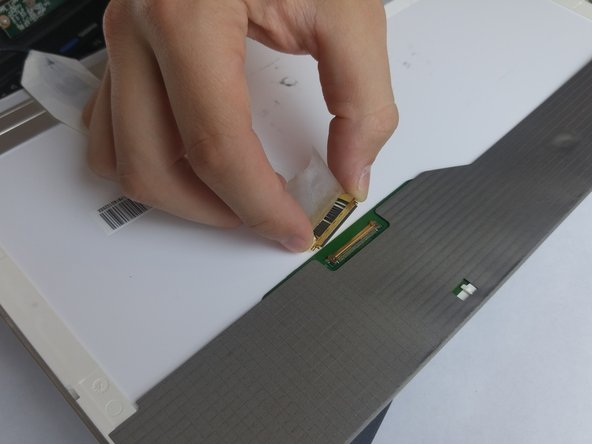 Peel the tape off the ribbon cable's contacts.