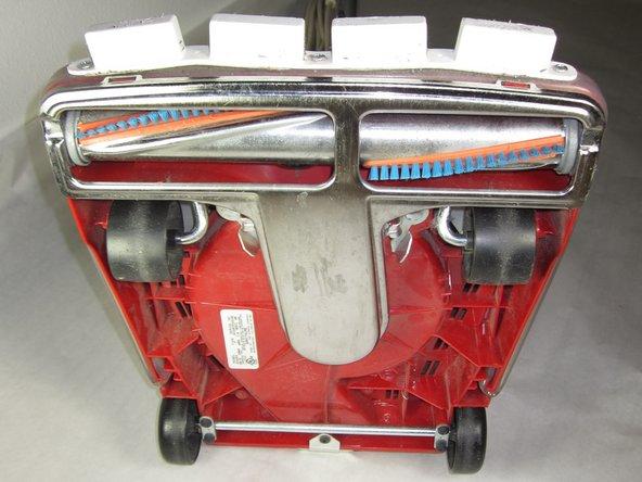 Image 1/1: Lay vacuum on its back