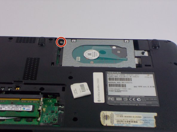 Remove the one 3.0mm Philip's #0 screw holding the hard drive in place.