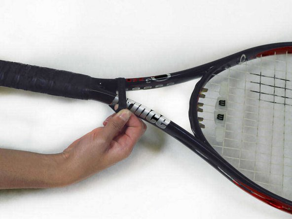 Pull the rubber collar towards the tennis racquet head off the handle.