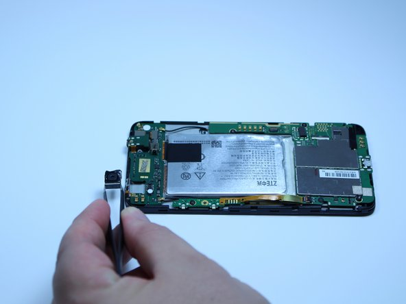 Image 2/2: With a pair of tweezers, gently remove the camera from its slot