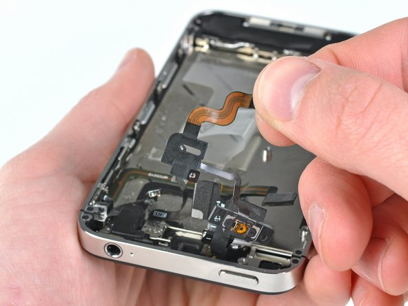 Remove the power button cable from the iPhone.