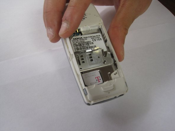 Once the SIM card compartment has been opened, insert the SIM card into the slot provided on the left side.