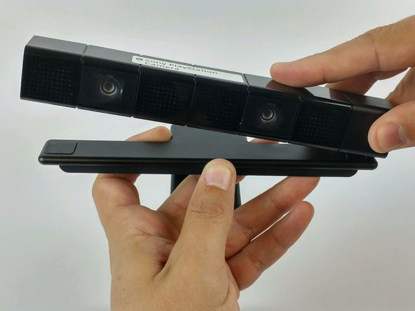 Separate the camera from the camera stand to gain access to the bottom of the camera.