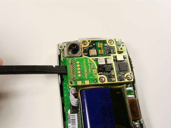 Use the spudger to lift the logic board from its socket.  Remove it from the rest of the phone.