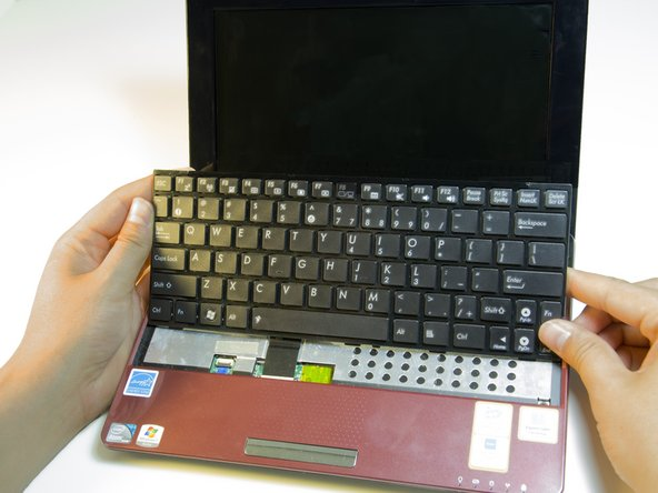 The keyboard should now lift from the base of the laptop.